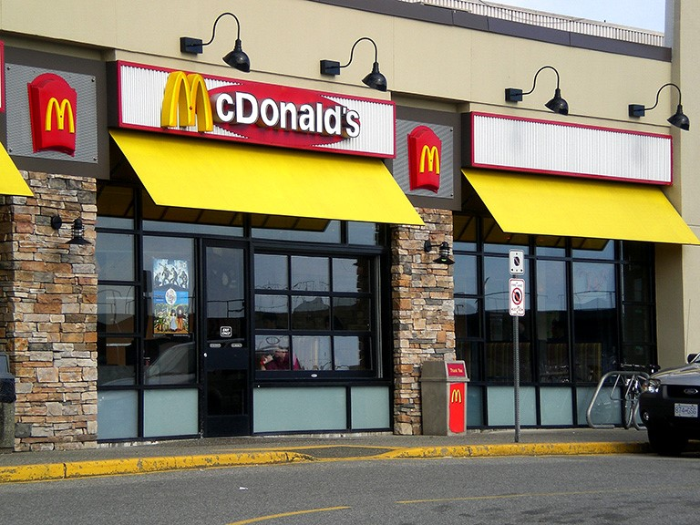 A McDonald's shopfront with colourful yellow awning