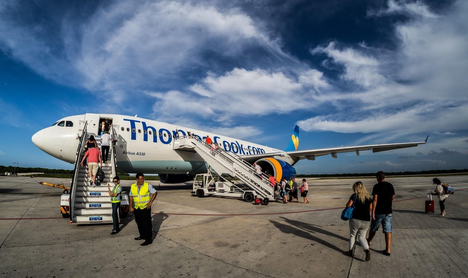People board a Thomas Cook aeroplane from the tarmac at Jardines del Rey Airport, Cayo Coco, Cuba. IMG: CWhatPhotos