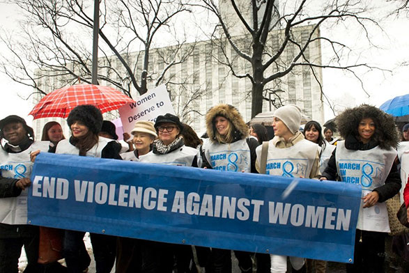 'UN Women For Peace' March Marking International Women's Day, with a group of women holding a banner stating 'End violence against women'
