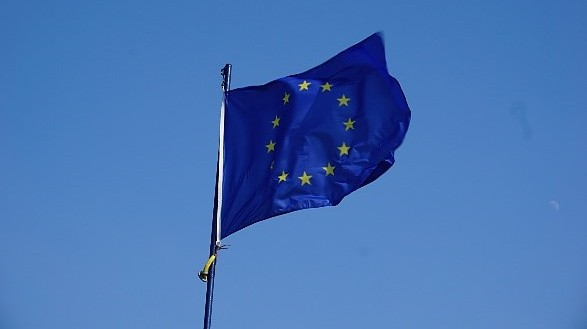 EU Flag blowing in the wind against a blue sky