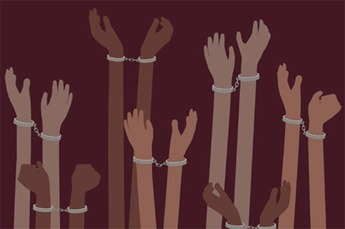 Pairs of hands in handcuffs reaching out
