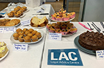 Cake stands set up for the LAC legal bake sale